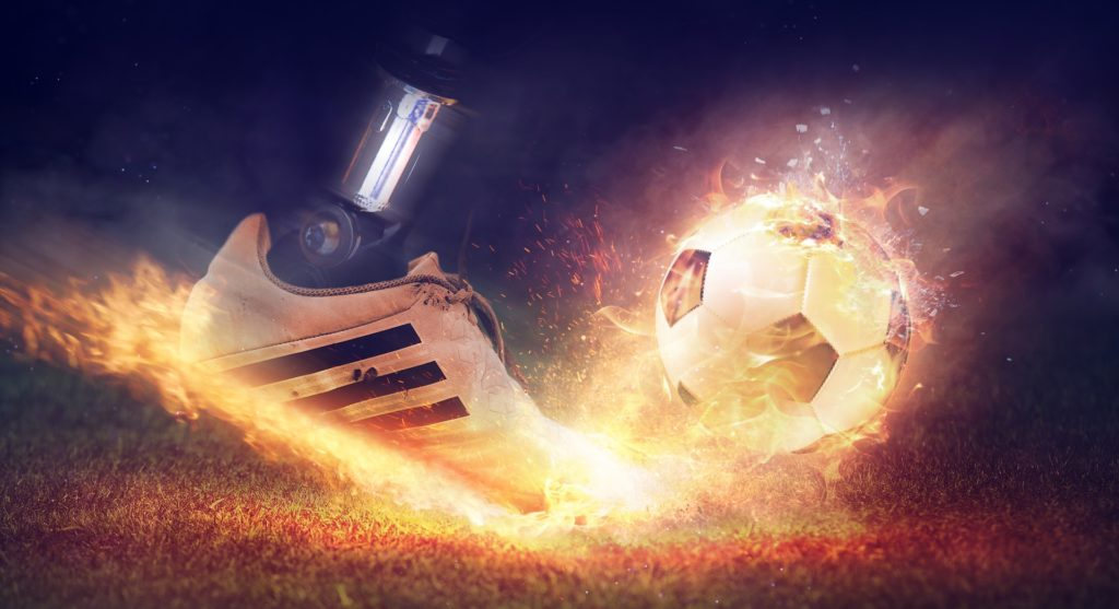 Image of a foot kicking a soccer ball