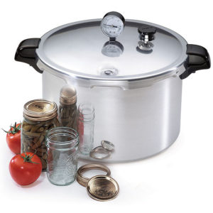 Pressure Canner with jsars and tomatoes on side